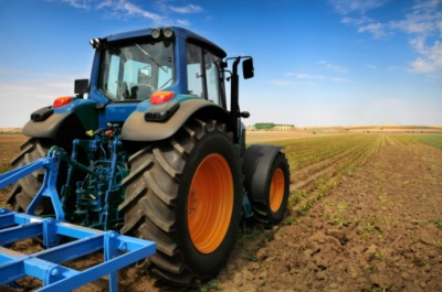 Tractor in field on farm