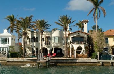 Mansion with chairs and palms
