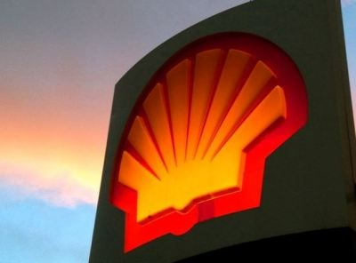 Shell sign at dusk