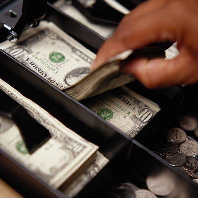 Close-up of Ten Dollar Bills in Cash Register Till