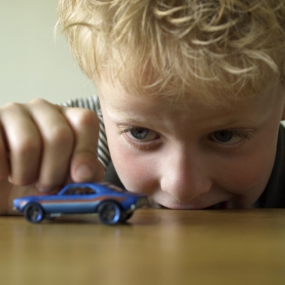 playing with toy car