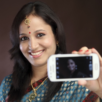India woman with mobile phone