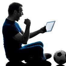 man watching tablet