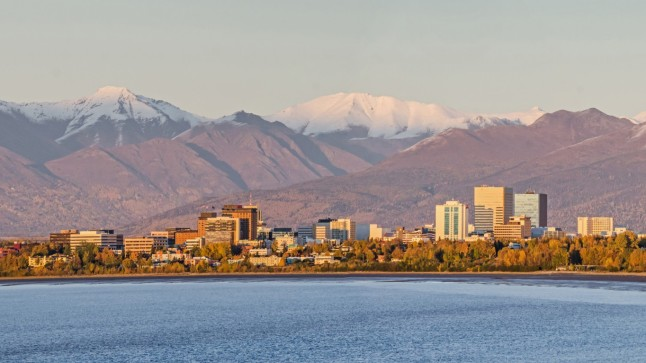 Anchorage, Alaska at sunset below the Chugach Mountains