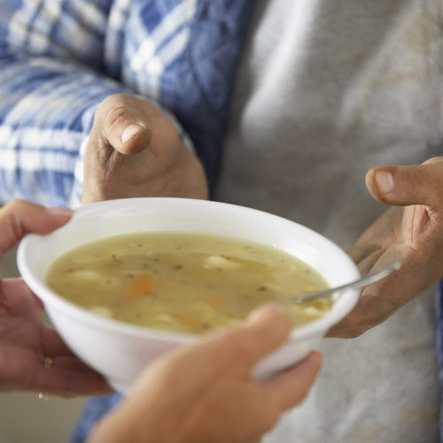 Handing soup, soup kitchen, hungry, hunger square