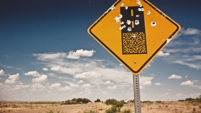 Road sign full of shotgun holes found at New Mexico, USA
