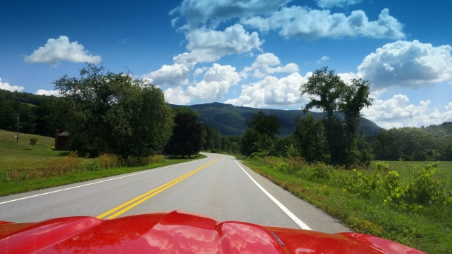 Red Sportscar Hot Rod Hood Driving into Vermont Mountains
