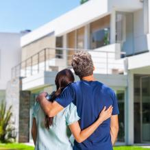 Couple family looking to new modern big house, real estate
