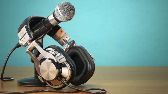 Microphone and headphones. Audio recording or radio commentator announcer