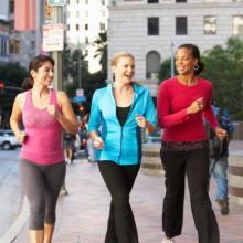 Group Of Women Power Walking On Urban Street