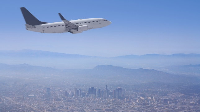 Los Angele Skyline with Airplane flying over, California