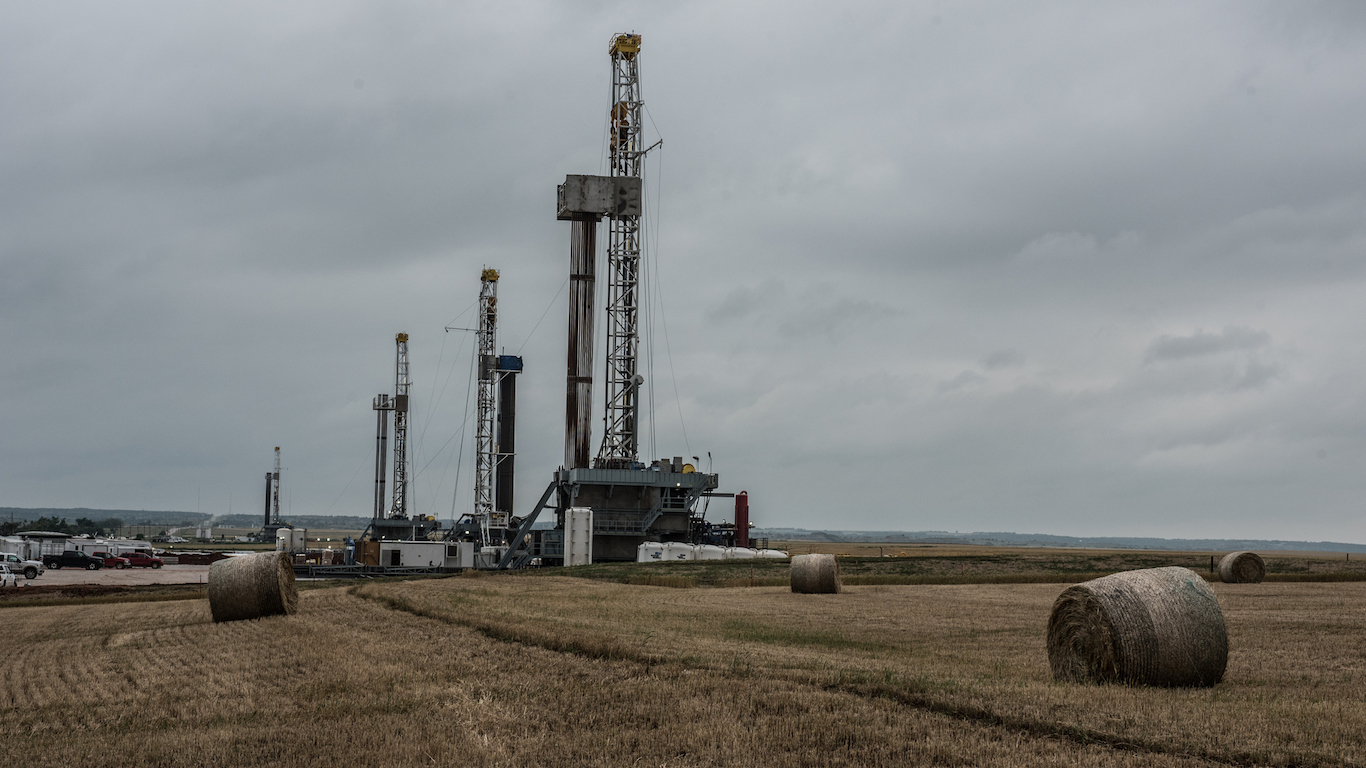 Fracking oil rig drills in Oklahoma field, gas extraction