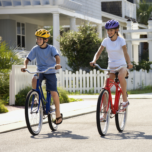 Boy and Girl Riding Bikes Safety