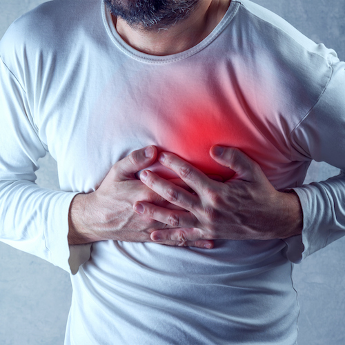 Severe heartache, man suffering from chest pain, heart attack