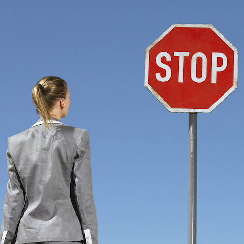 Businesswoman at Stop Sign, gender inquality