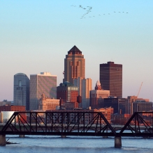 Skyline and Des Moines River in Des Moines, Iowa at sunset