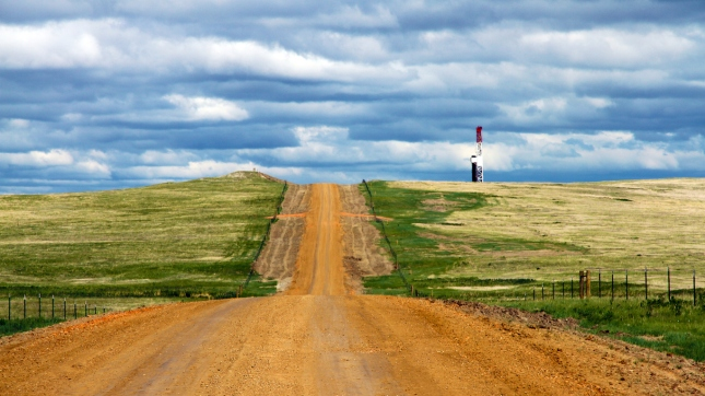 Distant Oil Rig on Bakken Road, Fracking, North Dakota