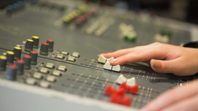 Student working on sound mixer
