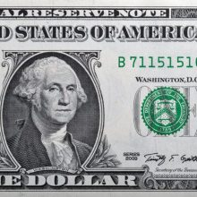 Portrait of the US President George Washington on one dollar banknote bill, front side obverse.