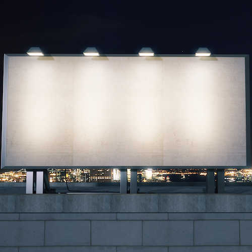 Big empty billboard on the background of the city