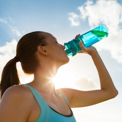 Female drinking water healthy lifestyle