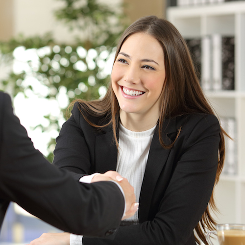 Businesspeople handshaking after negotiation, hired