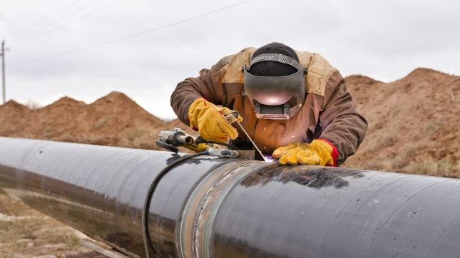 Welding works on gas pipeline, Oil and gas pipeline construction