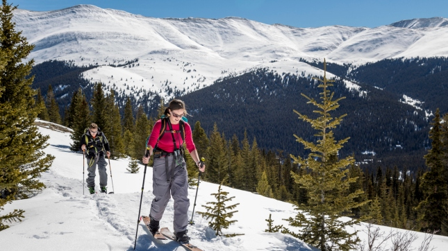 Two people touring on splitboards and alpine touring skis, Colorado backcountry