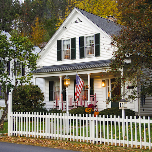 House with white picket fence middle class