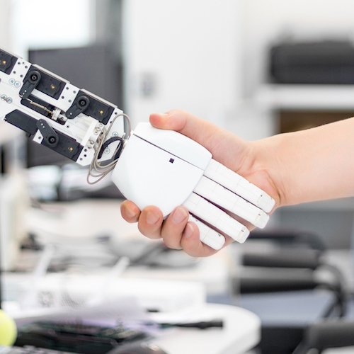 Techonology job robot hand holds the objects drawn to a man's hand